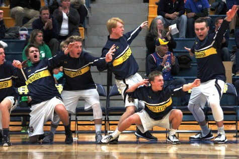 Five members of the boys basketball team dominate sidelines