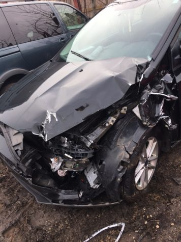 Side impact collision takes place in school parking lot