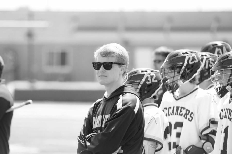 Junior Matt Olson stands on sideline during a lacrosse game. After suffering from a back injury Olson forced to the sidelines.