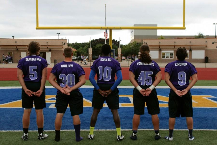 (From left to right) junior Levi Overway, senior Chase Pego, senior Aaron Cummings, senior Nick Mulachy and senior Joe Sepeshy show off their purple jerseys for the Bucs Pride game.