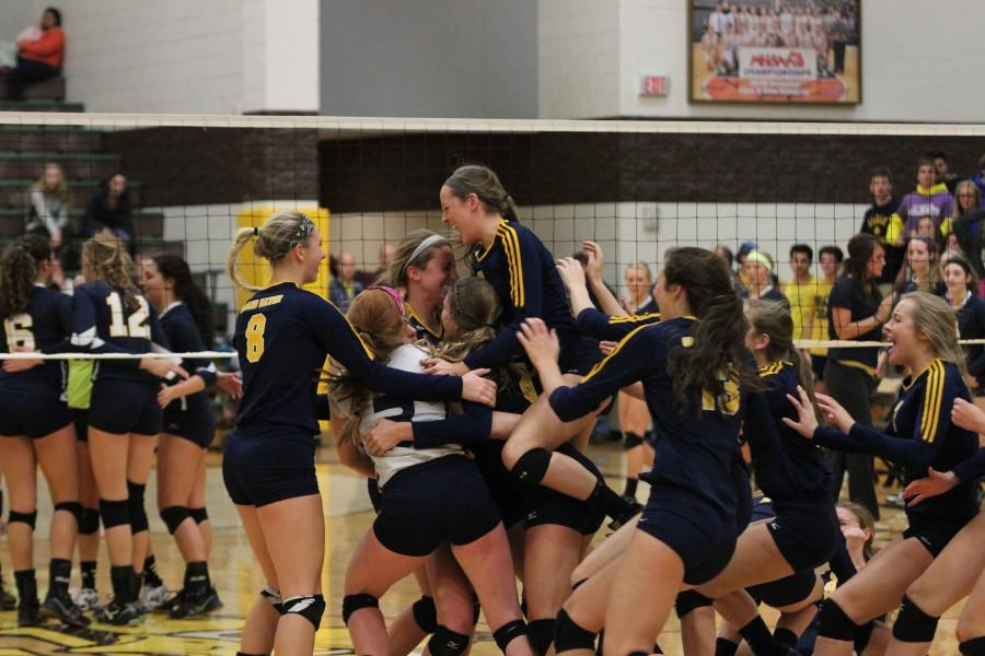 The team celebrates after the winning point during Thursday nights regional finals match. This is the Bucs second regional volleyball title in three years.