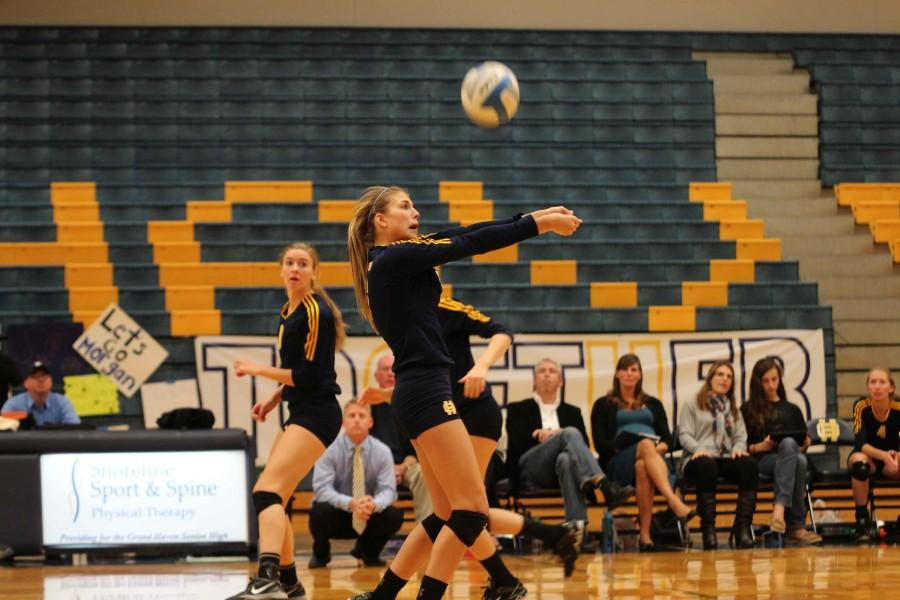 Sophomore Katie Cole passes the ball to a teammate in a home match. Cole leads the team with 1616 assists.
