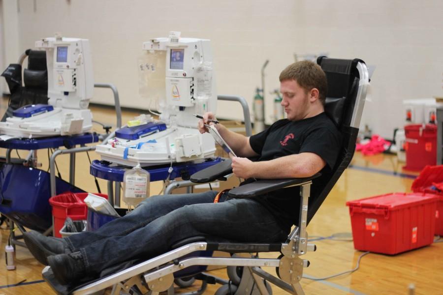 Senior Austin Rutherford prepares to donate blood.