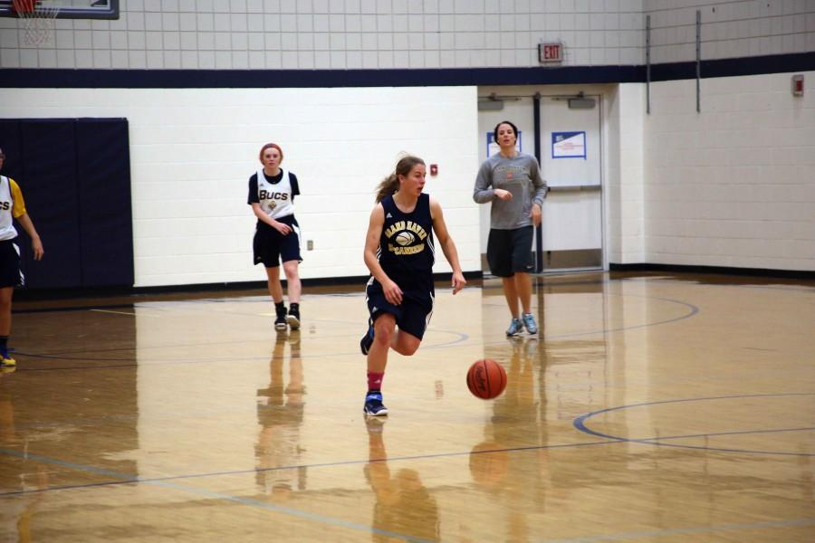 Senior Amanda Merz dribbles the court in a practice on Tuesday, Dec. 2. Merz averaged 4.9 points per game as a sophomore, 11.9 as a junior and will carry the scoring load in her senior season. I was more of a passer and more of a role player my sophomore year and then became a little more of a scorer my junior year, but now since Taylor [Craymer] and all them graduated, Im definitely more of a scorer and everybody is looking to me to make the play, Merz said.
