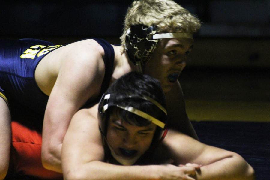 Senior Drake Morley in a match on Feb. 2, 2015 against East Kentwood. The Bucs defeated the Falcons 38-26.