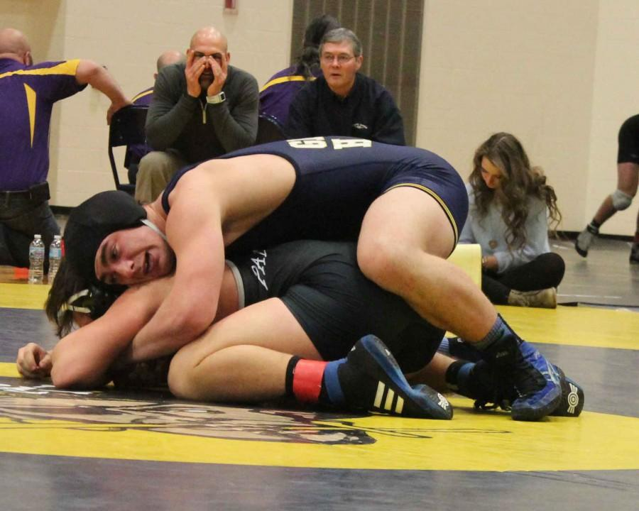 Senior 189-pound wrestler Nick Mulcahy breaks down Keenan Montoya of West Ottawa during the semifinal match at individual districts finals on Saturday, Feb. 14. Mulcahy went on to defeat Montoya in a 4-2 decision and advance to the finals.