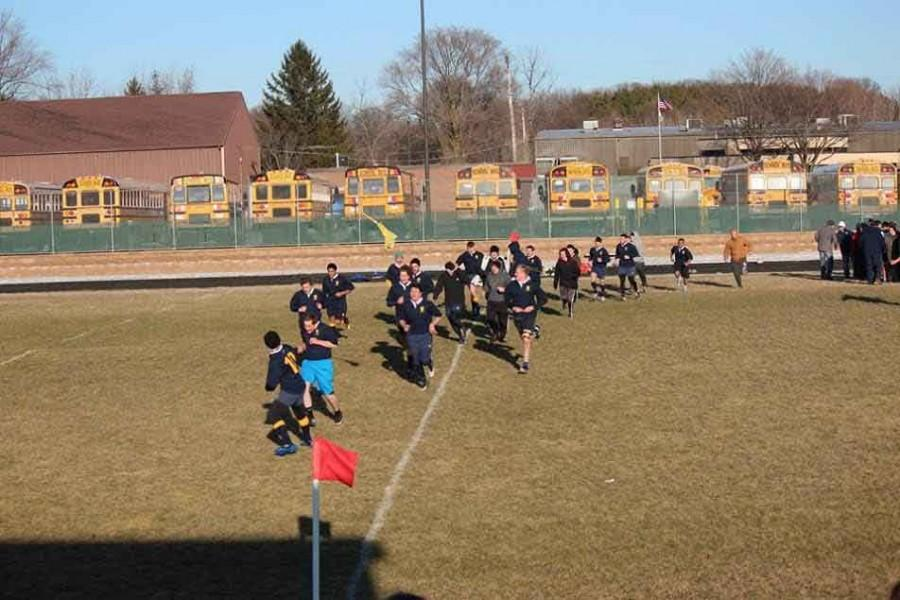 Senior+Drew+Danskine+leads+the+team+off+the+field+after+their+win+on+Friday%2C+March+27.+The+rugby+club+pulled+off+a+12-0+win+against+Catholic+Central.++