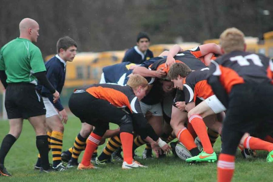 Rockford puts the ball into a scrum. The team's eight assembled players must fight for the ball.
