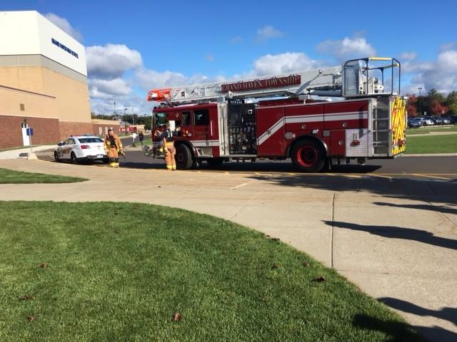 On Friday, Oct. 9 a fire truck from the Grand Haven township Fire Department arrives on scene after the fire alarms at Grand Haven high school were triggered.
