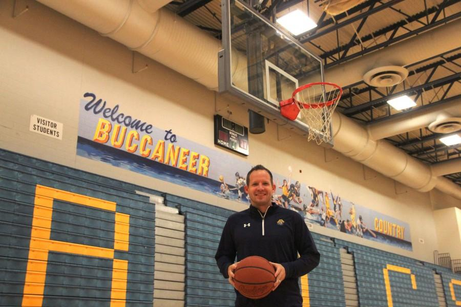New basketball coach, Greg Immink, brings a wide range of knowledge to the court.
