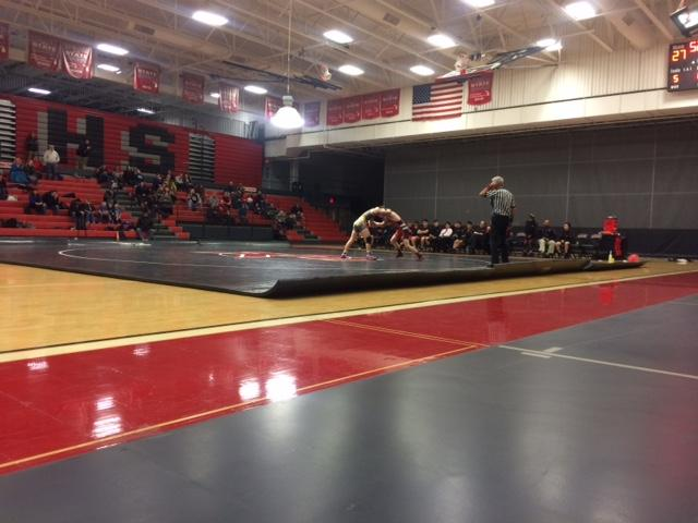 Wrestling team defeats East Kentwood in conference match, 38-30