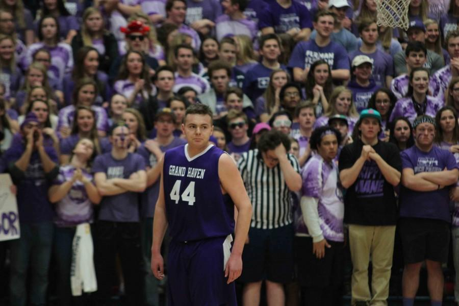 Senior forward Jason Long stands before the student section during the Bucs Purple Pride game on Feb. 28. Long led the team with 17 points, including four threes, helping the Bucs to a 61-51 victory over the Panthers.