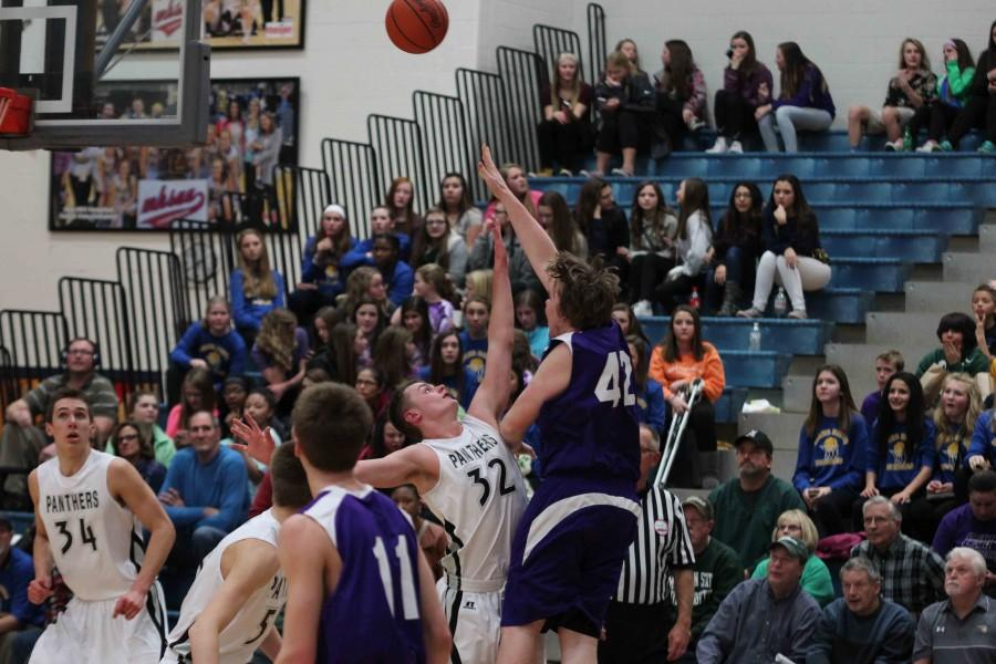 Senior forward Zac Sinke goes up for a shot over a West Ottawa defender. The Bucs claimed a share of the conference title after defeating the Panthers  61-51 on Feb. 28.