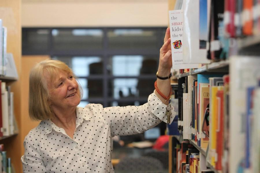 """LOOKING FOR ADVENTURE: Library media specialist Gloria Klinger places a book on the shelf. After 30 years of working in the district, Klingers retiring. """"Even though I love my job, it's time to take off and do some travelling, Klinger said. I will miss a lot."""