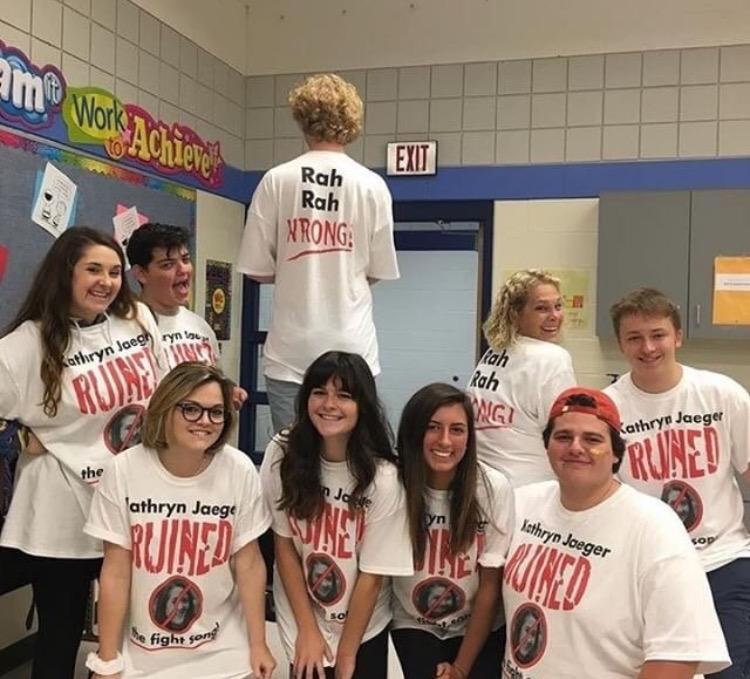 Senior Kathryn Jaeger (far left) poses with her friends in their custom designed T-shirts. The shirts read
