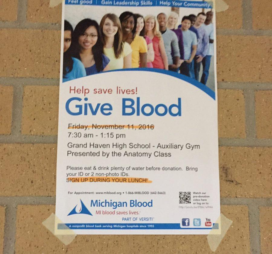 Posters in the hallways advertise the opportunity to give blood to help people in need. One donation has the potential to help save up to three lives.