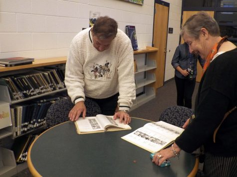 Grand Haven Alumni take advantage of the yearbook archive in the library.