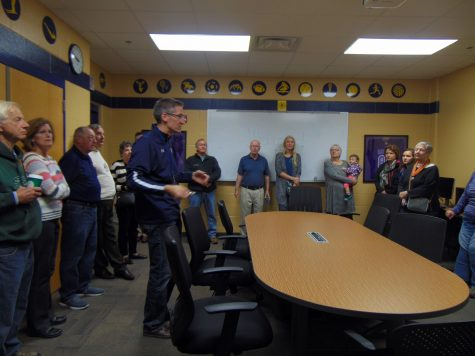 "Grand Haven Hall of Fame receive a tour led by Grimes. of the ""new"" high school building. Inductees saw all of the new improvements in the building, including the changes to the athletic offices."