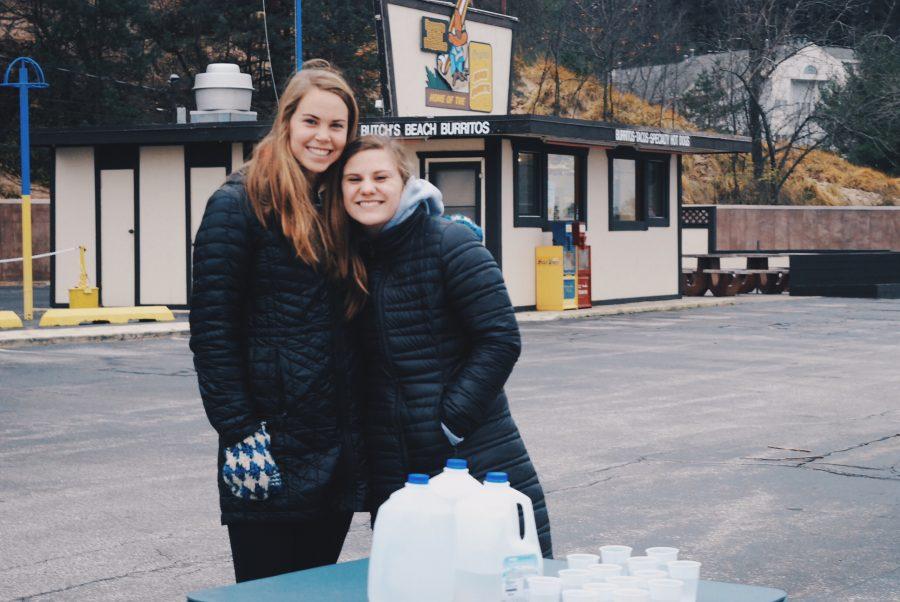 Senior members of NHS Jordyn Spruit and Sophia Kleyla are members volunteer at water stations in order to help make the event happen.