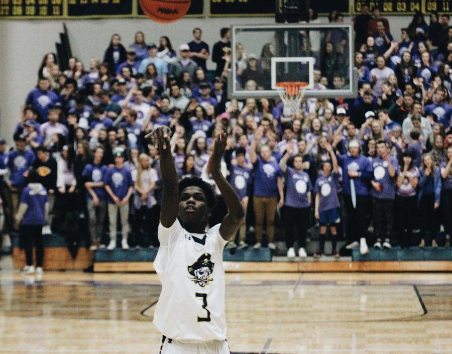 Junior Dimitrius Neely lines up for a free throw this past Friday. The stands filled with the students supporting cancer.