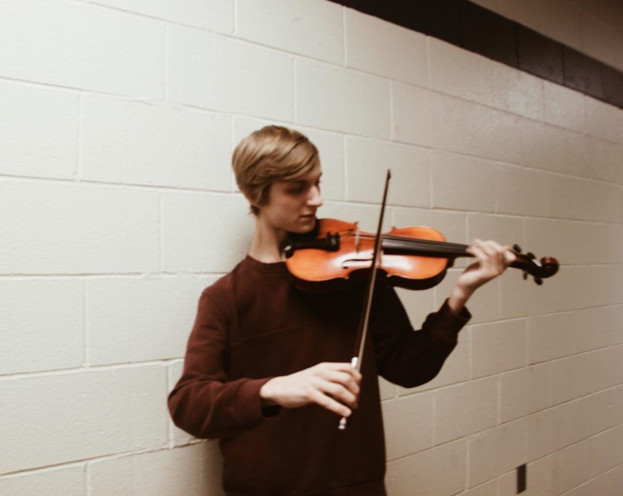 Eric Moerland playing the violin. He pursued all the performing arts offered.