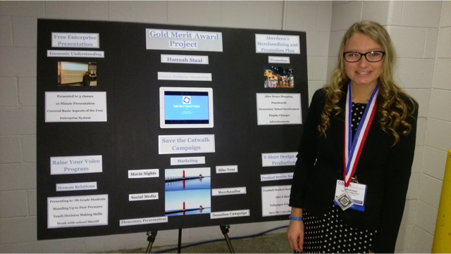Senior+Hannah+Staal+poses+with+part+of+her+DECA+project.+Staal+will+attend+the+International+Career+Development+Conference+National+Championship+in+California+on+April+26+for+her+achievements+in+DECA.