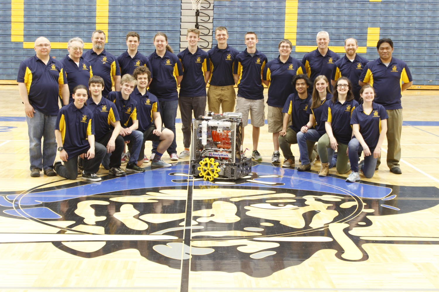 Our BucnGears robotics team posing with this years robot. They were able to go to states and worlds with this years game.
