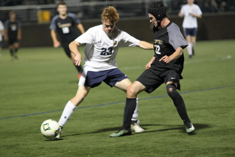 Junior Joe Walsh making moves on his defender during a home conference contest.