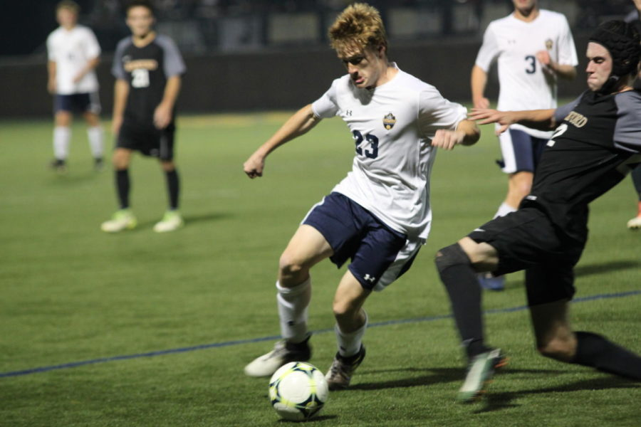 Junior Joe Walsh shows aggressive play and escapes defender in a home match against Rockford.
