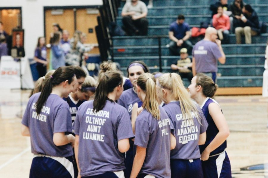 The Girls Basketball team joins together before their Purple Pride game last season. Returning leaders like junior Alli Keyser hope to bring the team to new heights this season.
