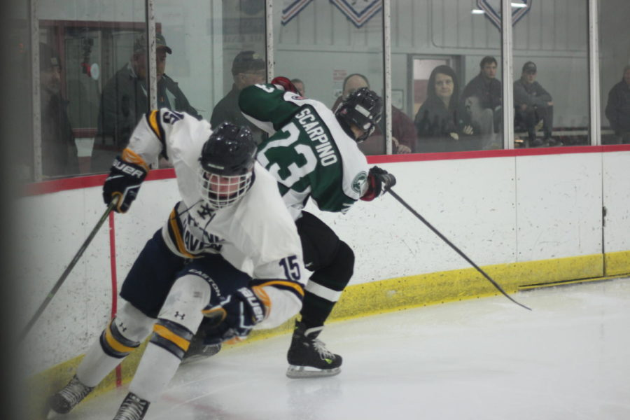 Junior Kyle Eveland attacks the net late in a contest during the Kentwood tournament this past weekend. Eveland needed to give it his all in order to help the Bucs pull out a much needed victory.