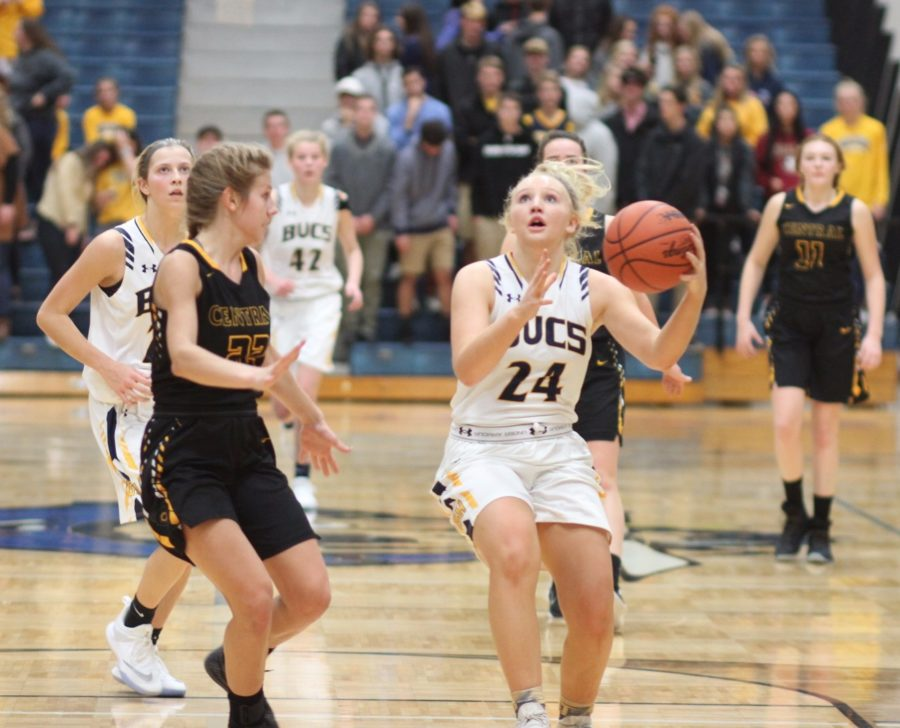 Junior Anna Strom goes up for a lay-up against Traverse City Central on Friday night, which was the first of two games in two days for Grand Haven. The Bucs only allowed a combined total of 22 points this weekend.