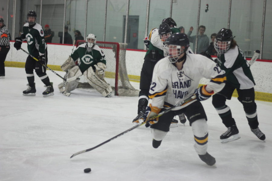 Sophomore Gavin Baldwin brings the puck back around during a rush toward the opposing teams net. Stellar defensive play paired with an unrelenting offense led the Bucs to easy win.