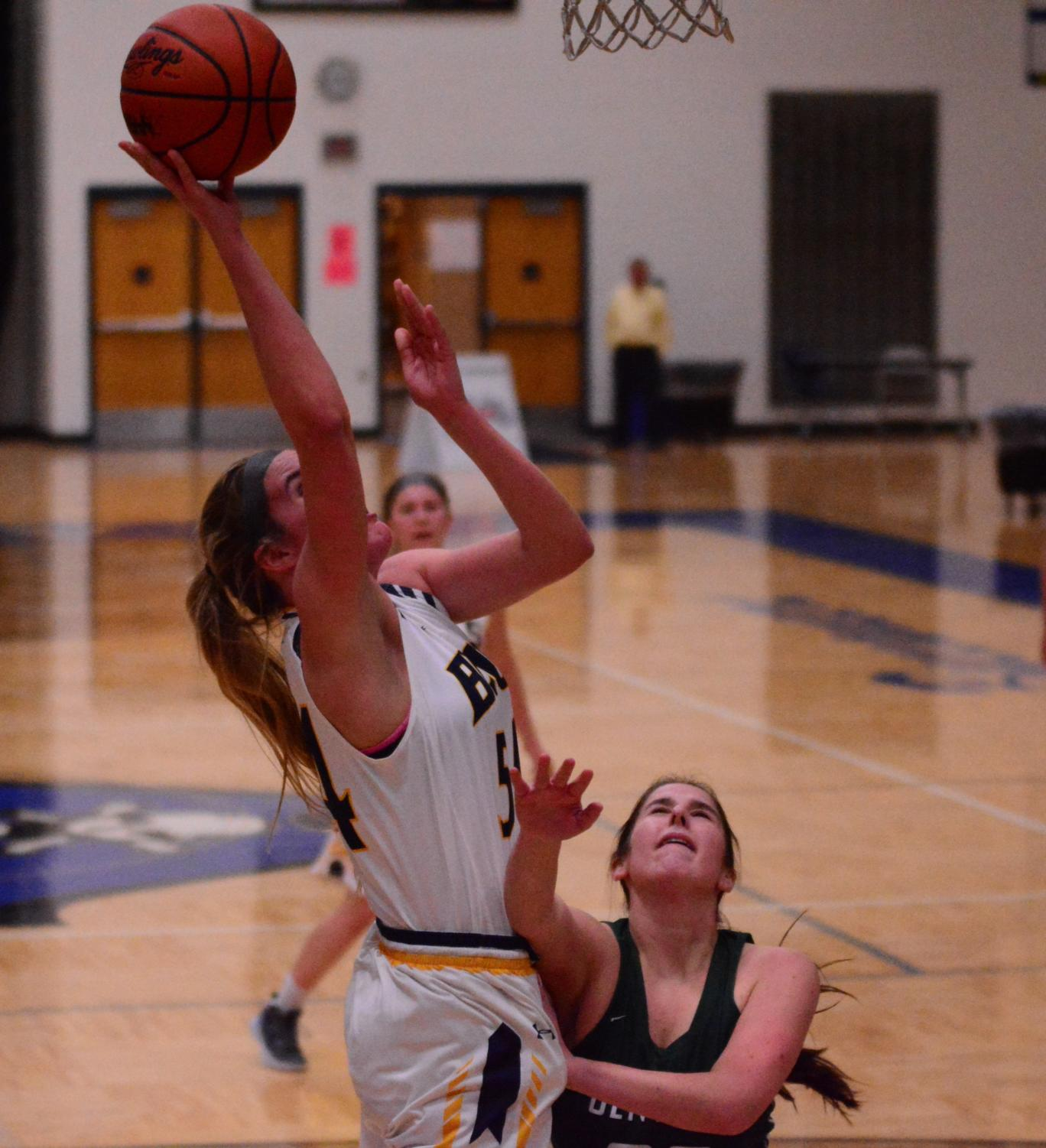 Junior Olivia McMullen goes up for a key put-back in a clash against Forest Hills Central. She will look to own the boards against the Rams tomorrow.