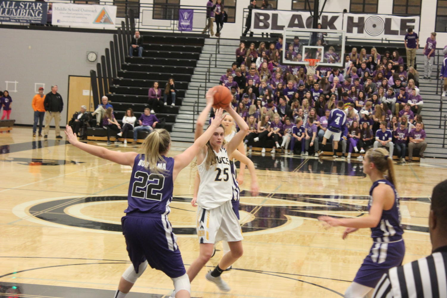 Senior Sophie Mariani challenges the brutal West Ottawa defense during a road game a few weeks back. The Lady Bucs turned it around last week, playing better, especially on senior night.