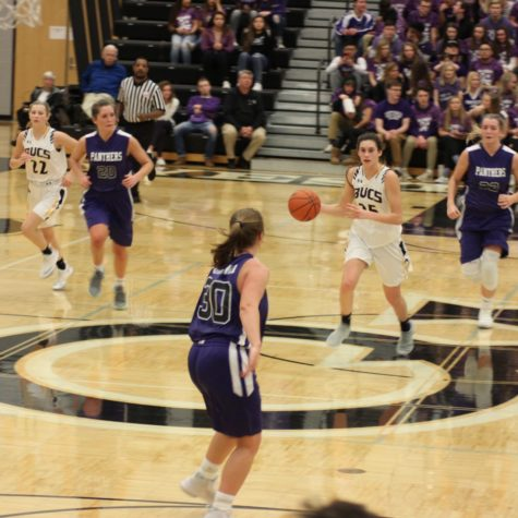 Senior Sophie Mariani takes the ball down the floor during a heated contest against the Panthers earlier this month.