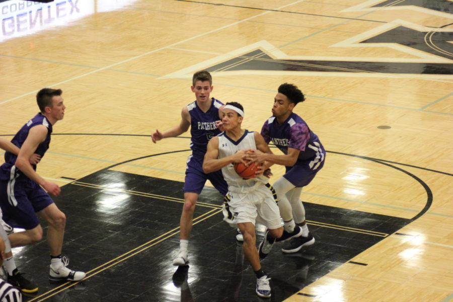 Malic Love drives to the basket, looking to score.