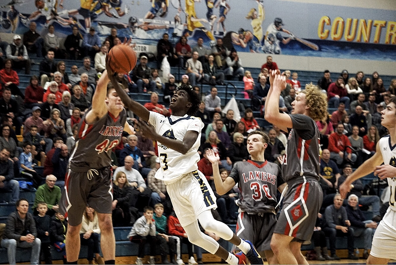 Dimitrius Neely with an aggressive take to the hoop against rival Spring Lake.