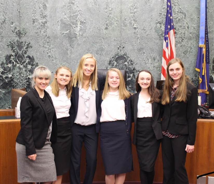 The+senior+Mock+Trial+team+stands+together+smiling.+These+members+received+honorable+mention+at+a+regional+tournament+on+Sat%2C+Feb.+24.+