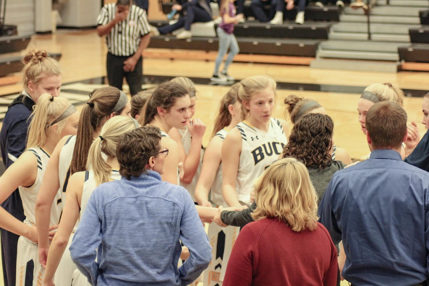 Coach Katie Kowalczyk-Fulmer huddles her team together in a conference matchup against West Ottawa. A team effort was crucial in Wednesday's win versus Mona Shores.
