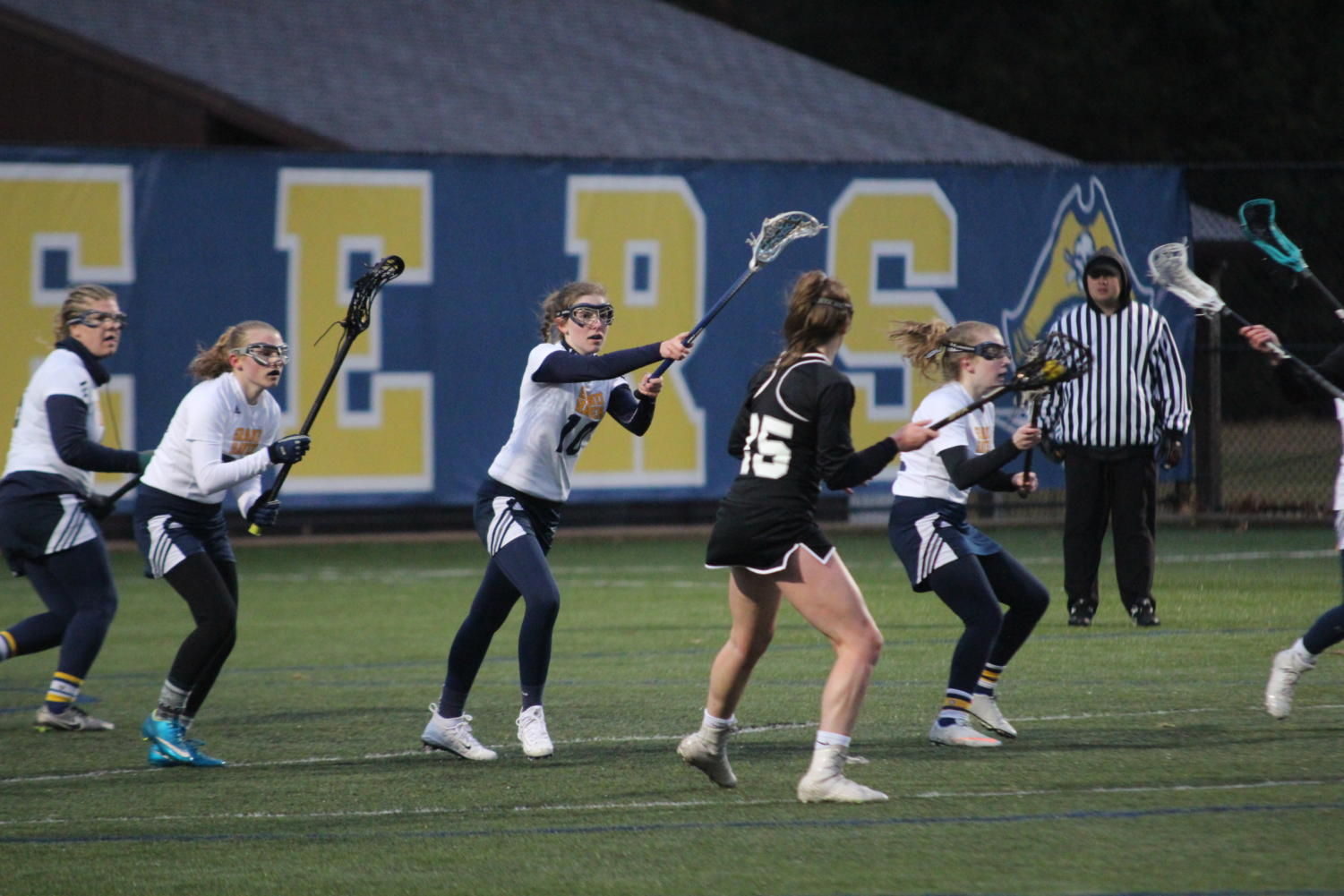 The Lady Bucs defense shuts down the opposing offense's charge into their third of the field. Led by senior Alexis Nesbitt (center) the Bucs stunted this attack