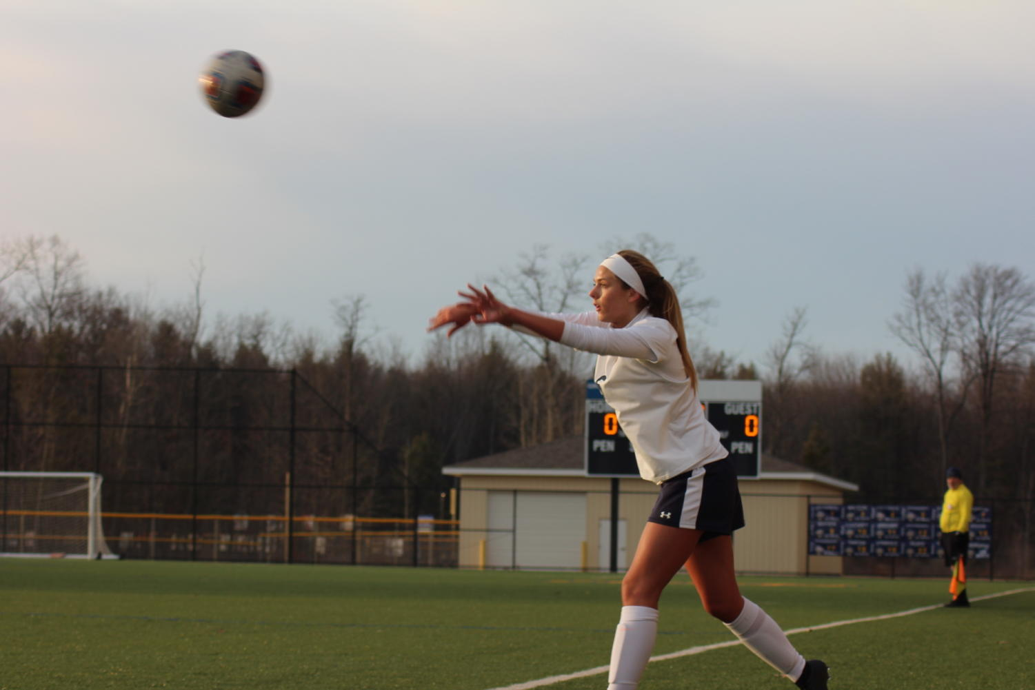 A Buccaneer completes a throw-in during the team's home match vs. Jenison