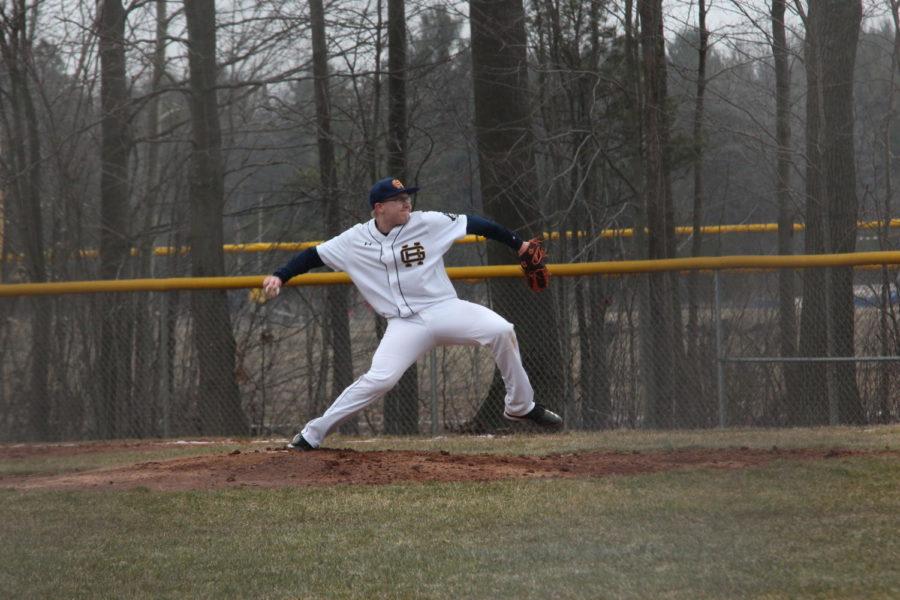 Junior+Brendan+VanDeWeghe+on+the+mound+pitching+to+Grandville+batter