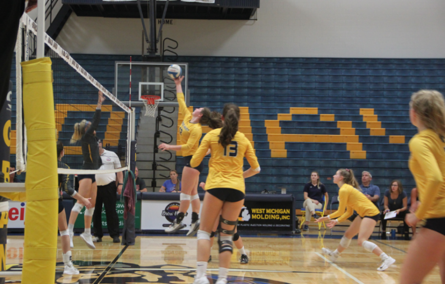 Junior+Sarah+Knoll+attempts+a+spike+against+Hudsonville.+The+Bucs+will+look+to+improve+on+offense+as+they+enter+the+final+stretch+of+the+season.