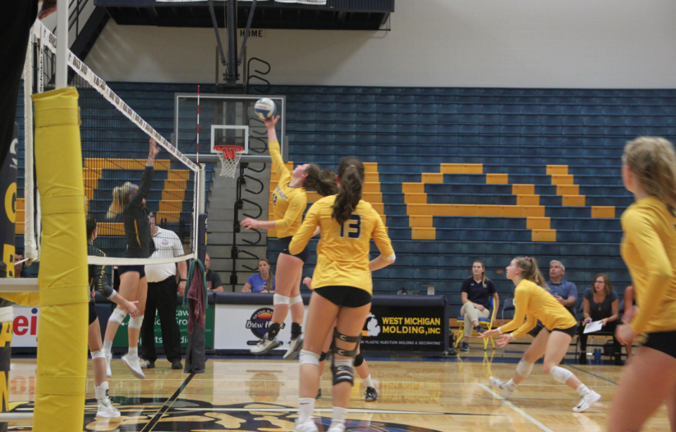 Junior Sarah Knoll attempts a spike against Hudsonville. The Bucs will look to improve on offense as they enter the final stretch of the season.