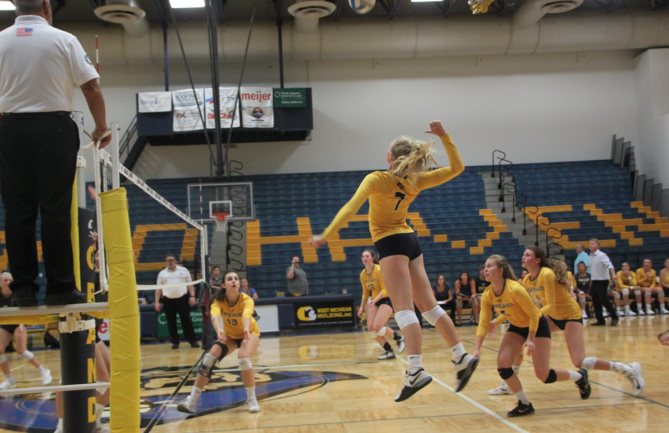 Sophomore Mackenzie Gross jumps up for a spike earlier in the year against Hudsonville. Consistent attacking play will be key to being a postseason threat.