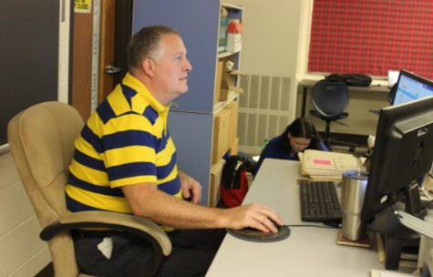 Teacher David Funk helps create a personalized schedule for one of many students that come to him for class advice. By having close connections with his students, Funk knows what will be best for their future