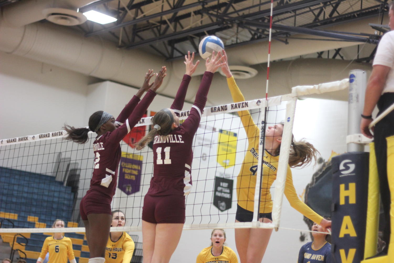 Junior Ashley Slater rises to spike a ball in a home match vs. Grandville. Slater has led the Bucs offensively this season.