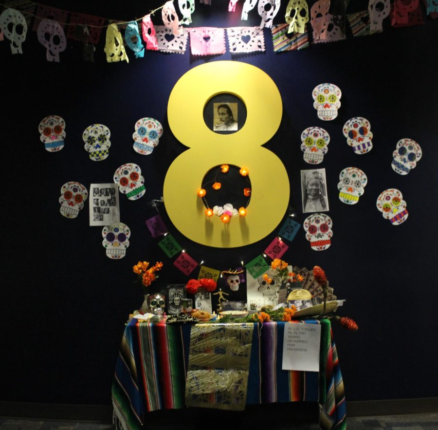 Student from the spanish 4 classes set up an altar at the entrance of Pod 8 to replicate a real