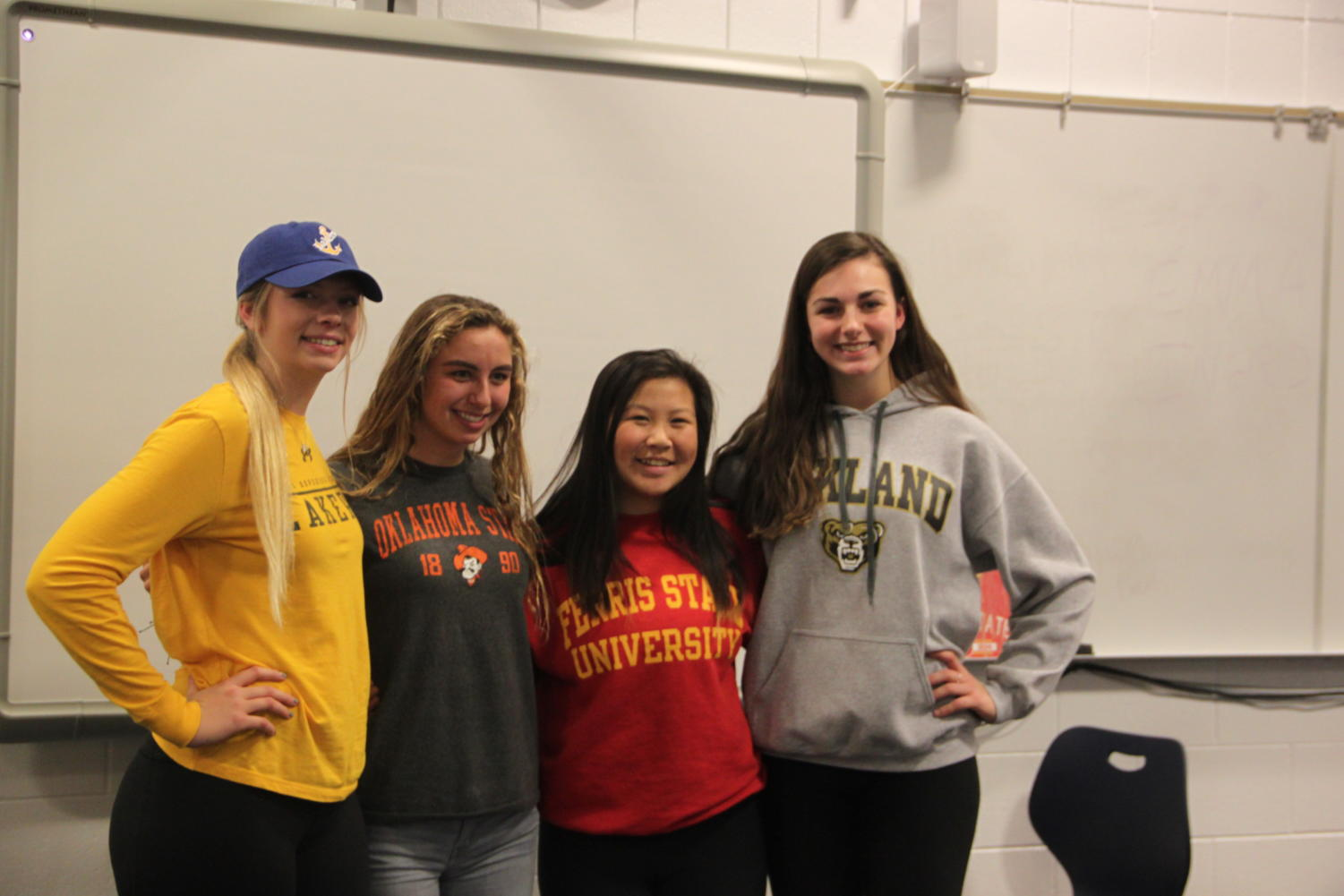 The four athletes pose together. From left to right: Avery Strohmeyer (Lake Superior State), Gabby Hentemann (Oklahoma State University), Baby Hang (Ferris State University), Avolyn Lepo (Oakland University).